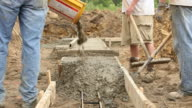 Construction Workers Pouring Concrete Footings video