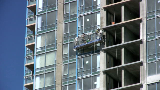 Construction Workers Working On New Highrise Building (HD 1080p30) video