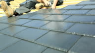 Construction Working Fitting Tile on roof video