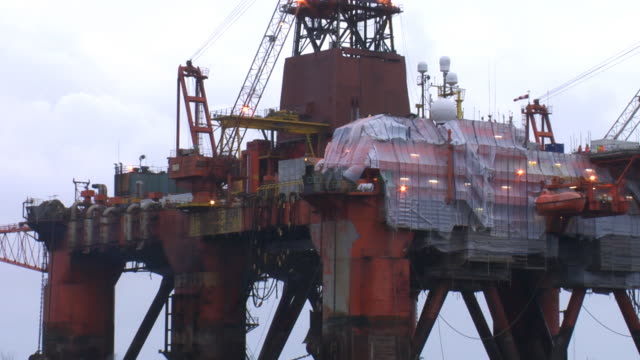 Constuction workers repairing an oil rig video