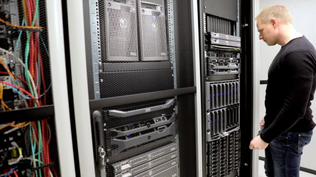IT consultant maintain rack server in datacenter video