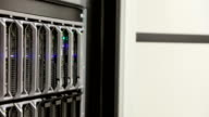IT consultant removes blade server in datacenter video