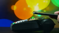 Contactless payment with Disco lights Bokeh background video