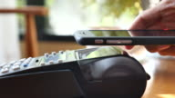 Contactless payment with smart phone in cafe video