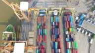 4K : Container Cargo freight ship with working crane bridge in shipyard video