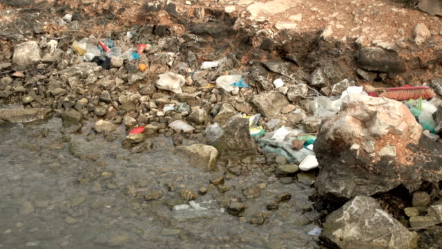 Contamination of the sea. Piles of garbage waste environmental disaster on a sea shore video