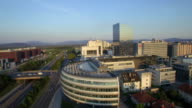 AERIAL: Contemporary business district at summer sunset video