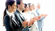 Contemporary business people applauding on a conference. video