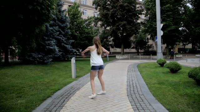 Contemporary caucasian ballet street dancer woman urban dancing freestyle in the city video