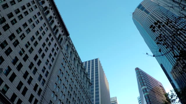 Contemporary office buildings and glassy skyscrapers in city downtown video