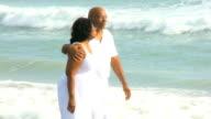 Contented Senior Ethnic Couple Quiet Beach Time video