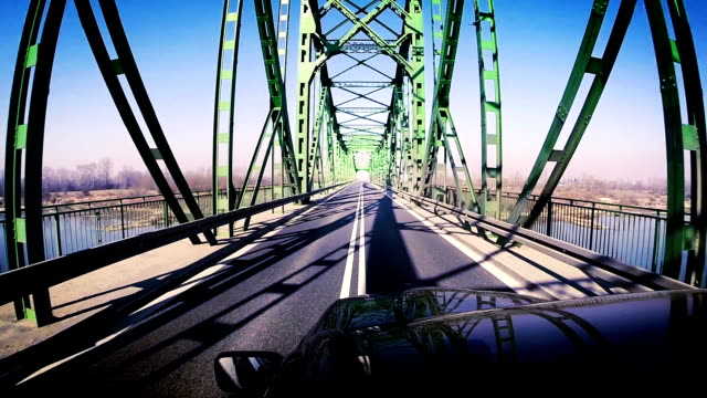 Contrasty footage: car's crossing the river by the bridge video