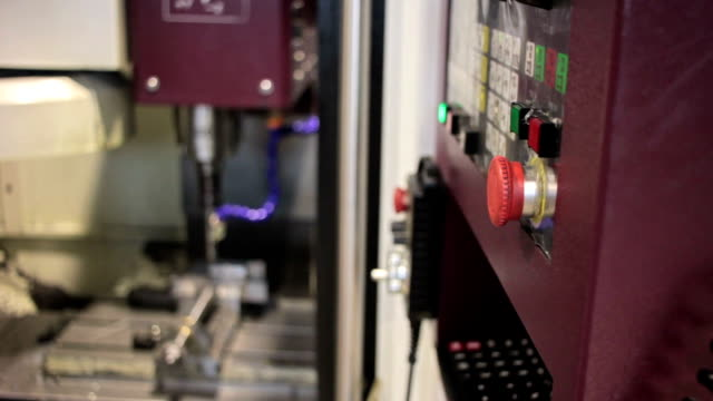 Control Panel CNC.  Machine milling  steel part on background video