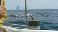 control sails in a sailing race video