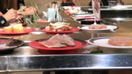 Conveyer belt shabu buffet , Bangkok , Thailand. video