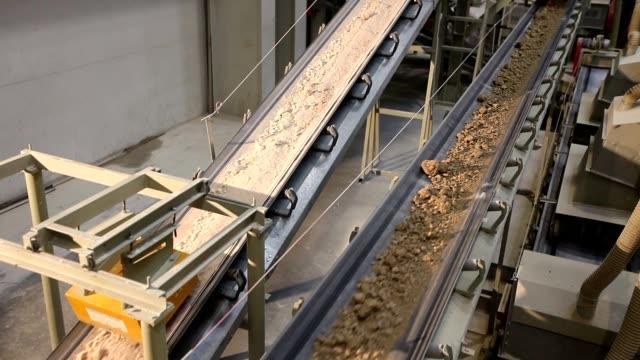 Conveyor belt on industry, Ceramic factory equipment, Transportation of clay on the conveyor video