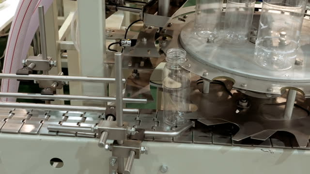 Conveyor product line for pouring beverage bottles video