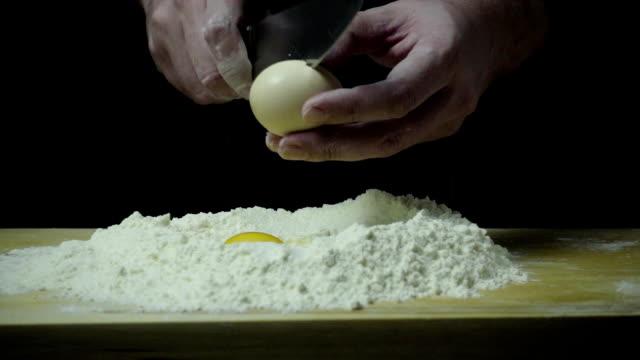 Cook breaks egg knife super slow mo video
