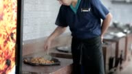 Cook pilaf mixes in the boiler in the kitchen. video