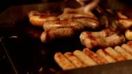 Cook prepares sausages. video