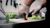 Cook slices cherry tomatoes. video