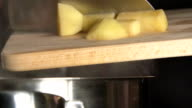 SLOW: Cook throws a sliced potato (close up) video