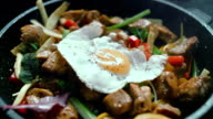 Cooked meat meal with vegetables, egg in a pan video