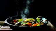 Cooked meat meal with vegetables in a pan video