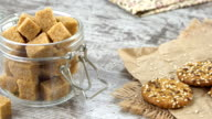 Cookies and a bowl of brown sugar on a rustic wooden table video