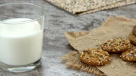 Cookies and a glass of milk on a rustic wooden table video