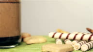 Cookies and coffee on a white table rotation video