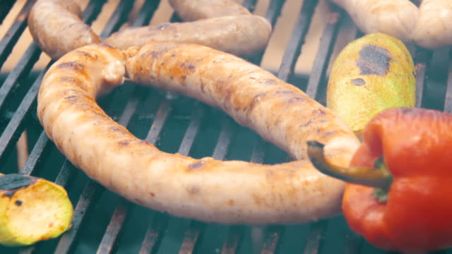 Cooking Barbecue Delicious Sausages and Vegetables on the Grill video