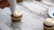 Cooking cupcakes. Apply cream. Close-up. video