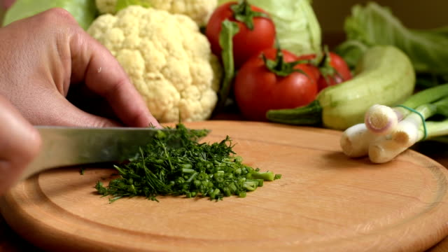 Cooking. Cutting fresh dill. video