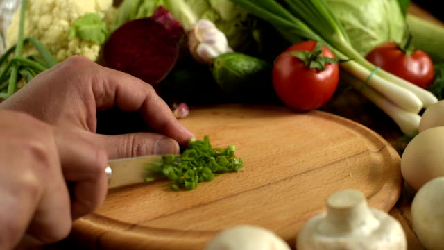 Cooking. Cutting green onions video