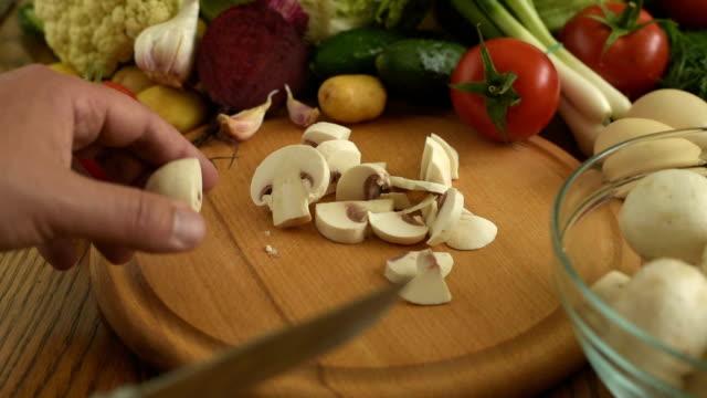 Cooking. Cutting mushrooms video