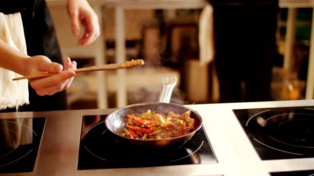 Cooking fajitas . Close-up video