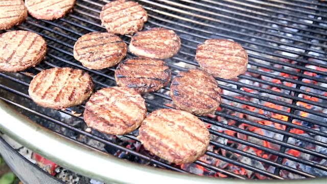 Cooking hamburgers on the grill. video