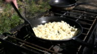 cooking hash browns outdoors video