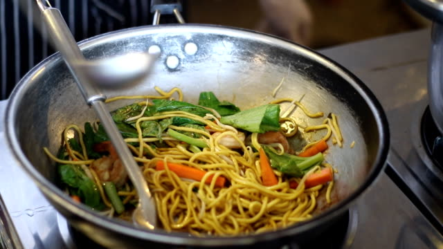 Cooking hokkien-style fried noodles in the buffet line video