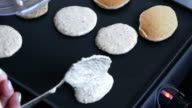 Cooking home made oat pancakes on electric barbecue video