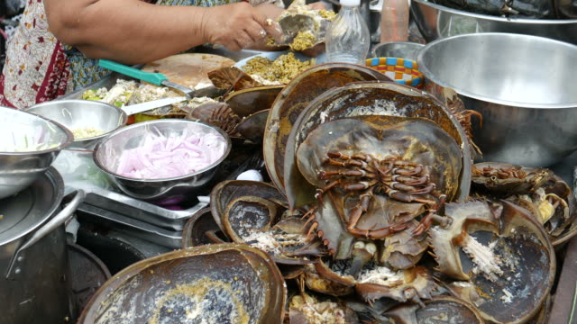Cooking horseshoe crab for eating, street food, Thailand video