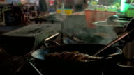 Cooking in street restaurant of Bangkok, Thailand video