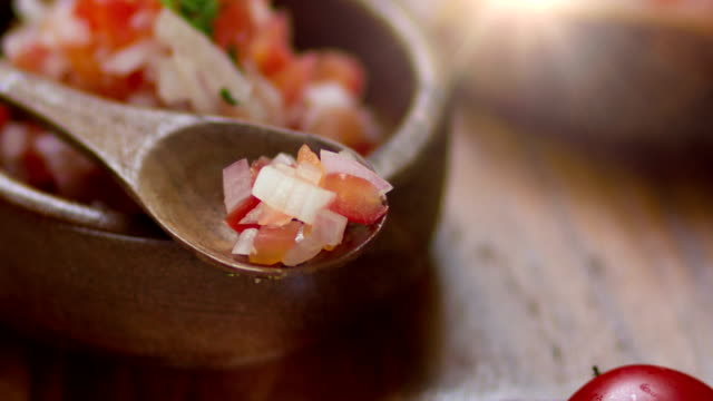 4K Cooking ingredients for bruschetta with tomatoes. video