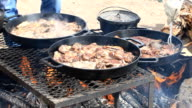 Cooking lamb steaks outdoors video