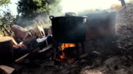 Cooking outdoors in cast-iron cauldron. video