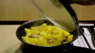 Cooking potatoes in a pan. Fragrant fried potatoes video