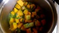 Cooking pumpkin inside pan video