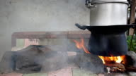 Cooking rice using traditional stoves video