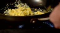 Cooking Scrambled Eggs for Breakfast video